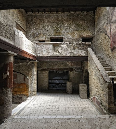 Excavated Ruins Of Herculaneum - the town was destroyed during the eruption of Mount Vesuvius on 24 August 79 CE. this house is known as 'Casa del bel cortile' located along the Cardo V