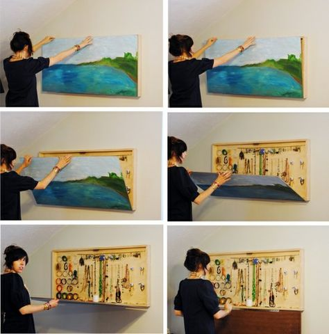 diy jewelry organizing ideas hidden behind painting. What a great space saving idea!