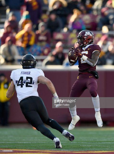 Tyler Johnson Of The Minnesota Golden Gophers Catches The Ball Minnesota Football College Football Uniforms Pop Warner Football