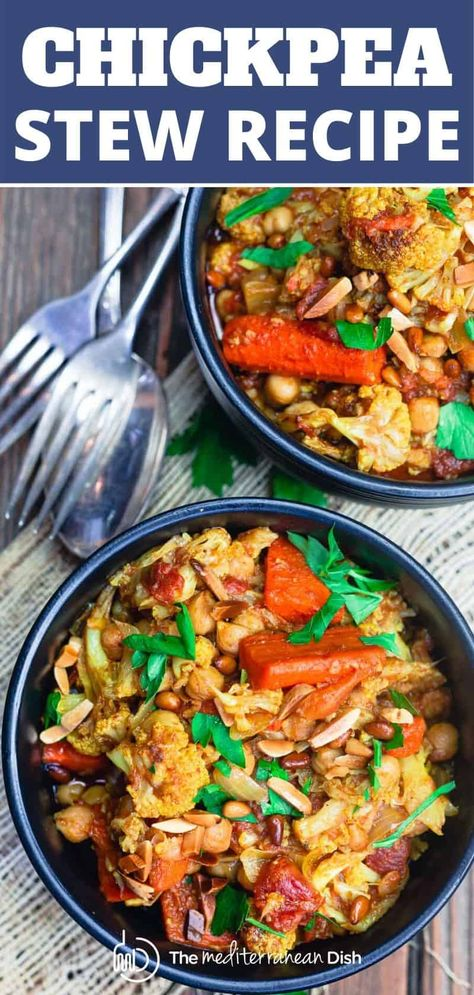 Oh my! This chickpea stew is loaded with warm flavors and packed with veggies like roasted cauliflower and carrots. It is so hearty and delicious. Grab the recipe. #chickpearecipe #chickpeastew #chickpeas #mediterraneandiet #mediterraneanrecipes #moroccanrecipes