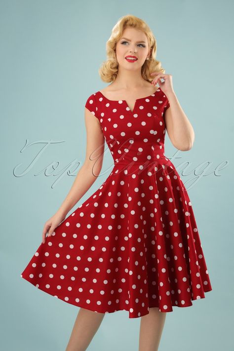 It's always party-time with this 50s Nicky Polkadot Swing Dress in Red and White hanging in your closet!With her elegant boat neck, playful cut-out and sassy polkadots, she truly is a party-classic! The fitted bodice and the flattering, full swing skirt give you a typical fifties silhouette, especially if you wear a petticoat underneath ;-) Made from a breezy, bright red cotton blend with a light stretch that's covered with white polkadots. Can you picture yourself dancing the night away in this