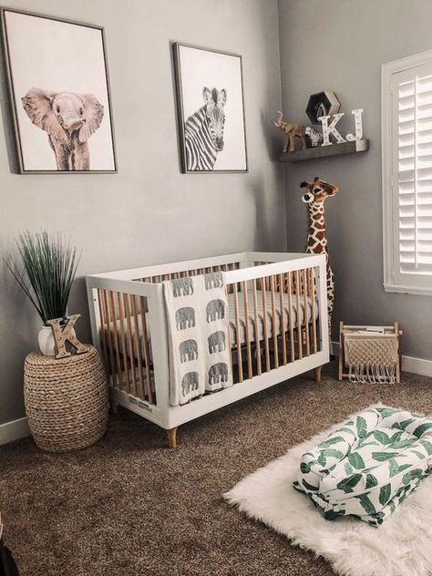 gender neutral boho safari jungle nursery with giraffe plush and elephant baby blanket #nurseryideas #nurserydecor