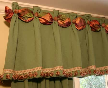 Interesting detail with the ribbon and buttons on this valance