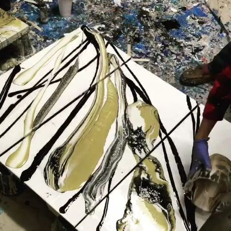 Paint pouring a triptych with black, white and gold!