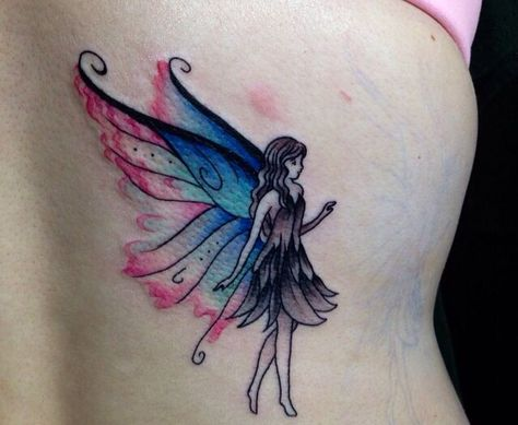 Watercolored fairy tattoo - We really like what they did with the colors in this design
