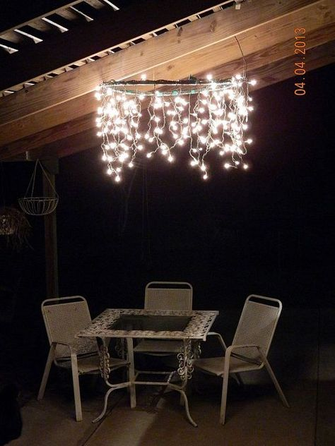 Hula Hoop Chandelier (hula hoop, spray paint, 2 strands of icicle lights, electrical tape and some heavy fishing line).