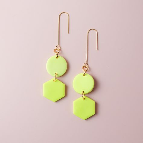 Description #NeonYellow The Belle dangles are a classic shape around here. In this bright neon yellow they swing and sway even more eye-catching-ly! #BlackTexturedLines The Belle dangles are a classic shape around here. The texture on the black shapes adds extra dimension as they swing and sway so elegantly (and eye-catching-ly) with these long u-hooks! #BlackandWhite The Belle dangles are a classic shape around here. In a Black and White composite, they swing and sway so elegantly (and eye-catc