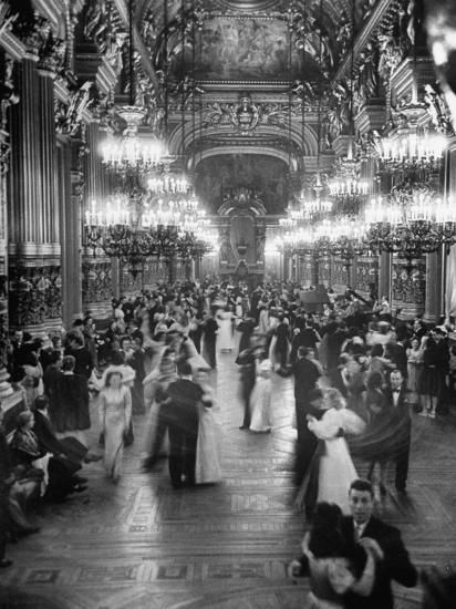 Couples dancing in the Grand Foyer of the Paris Opera House at a Victory Ball. Paris, France, May Photographer: David E.