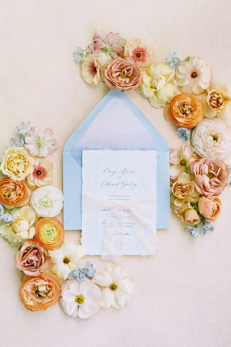 From the editorial Sunset on the Seine by Claude Monet Inspired This Spring Wedding Editorial's Color Palette. The blooms surrounding this gorgeous invitation suite were inspired by the magical season of spring. We cannot stop swooning! The full gallery is on SMP!  Photography: @lisasilvaphotography  #weddinginvitations #invitationflatlay #floralweddinginvitations #springwedding #invitationsuite