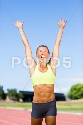 Excited Female Athlete Posing After A Victory On Racing Track Stock Photos Ad Athlete Posing Excited Female En 2020