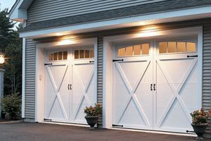 Our Garage Door Model 167t Is Made With An Insulated Steel Construction And Fashioned To Resemble The Eleg Carriage House Doors Garage Doors Garage Door Design