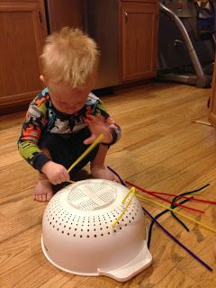 Pipe cleaners plus colander! This helps with fine motor skills, hand, eye coordination