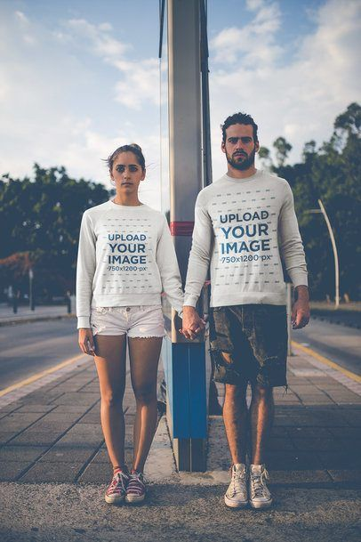 Download Placeit Serious Couple Holding Hands Wearing Crewneck Sweaters Mockup Outdoors Sinful Clothing Sweatshirts Soft Sweatshirts