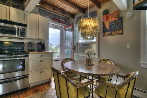 Eclectic Dining Room with Pella Architect Series Hinged Patio Door with Traditional Grille, Hampton Cabinetry, French doors