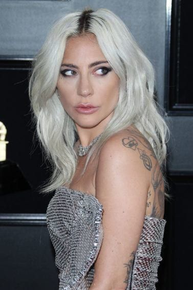 Lady Gaga With Silver Blonde Waves Wearing Silver Dress On The Red Carpet Silver Blonde Hair Lady Gaga Hair White Blonde Hair
