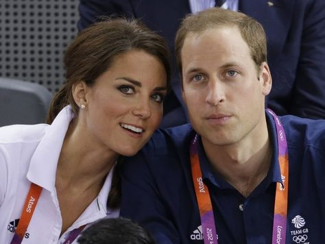 Prince William, right, and wife Kate, Duke and Duchess of Cambridge, watch track cycling at the velodrome during the 2012 Summer Olympics, Thursday, Aug. 2, 2012, in London.