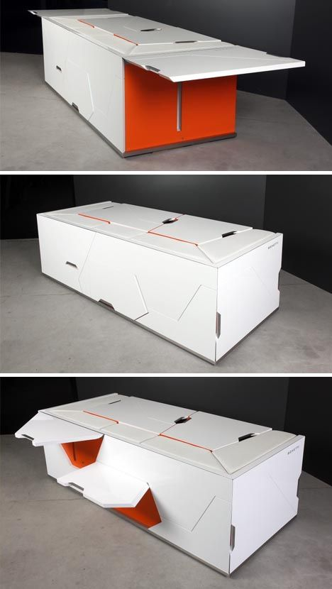 a table that turns into a sofa with foot rests and an office in