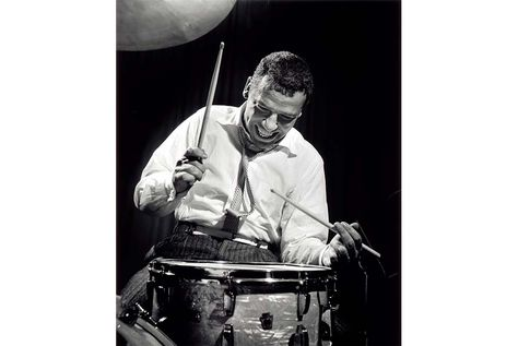 The GREAT BUDDY RICH. Never taught, never read music, never practised, but could keep a steady beat with spoons at the age of one and was a bandleader at the age of Acclaimed drummer, Buddy Rich ©Herman Leonard.