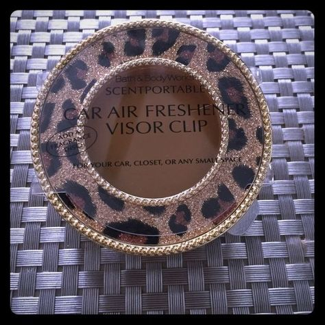 Leopard bath & body works car visor freshner clip Brand new. Never used. Caribbean escape scent portable fragrance refill. That comes with it Bath & body works Other bathbodyworks #cargoals #carairfreshener #cardetailing #carcar #caraccessories #itworks #fragrance #bad