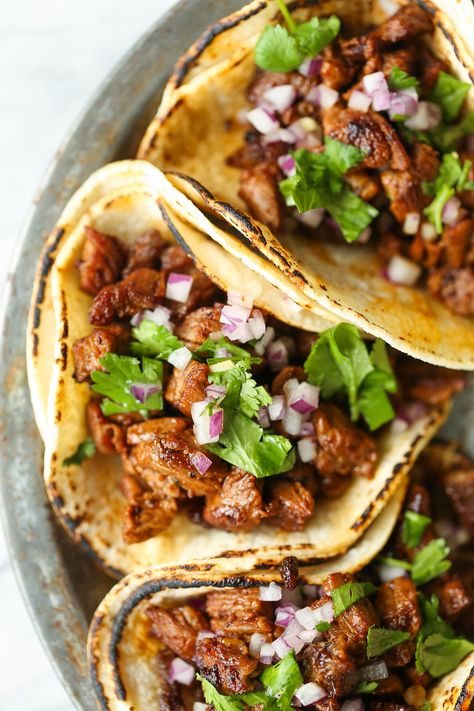 Mexican Street Tacos - Easy, quick, authentic carne asada street tacos you can now make right at home! Top with onion, cilantro + fresh lime juice! SO GOOD!