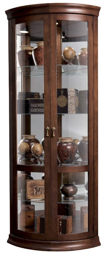 This Chancellor Corner Curio Cabinet Features Five Levels Of Display Space  With Three Glass Shelves And One Wood Shelf With Glass Insert And Glass  Mirrored ...