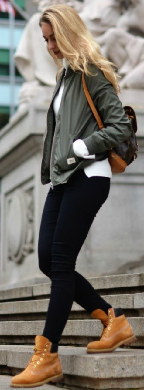 If you're looking for a smart/casual way to wear Timberland boots, Vanessa Ciliberto is showing you the answer! Combine fresh Timberlands with skinny black jeans and a khaki bomber to achieve this effortlessly chic look!  Shoes: Timberlands, Jeans: Topshop, Backpack: Louis Vuitton