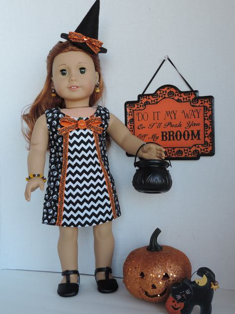 Black and orange Halloween dress by BrownDaisyDesigns on Etsy. Made using the Sunshine Dress pattern. Get it at http://www.pixiefaire.com/products/sunshine-dress-18-doll-clothes. #pixiefaire #sunshinedress