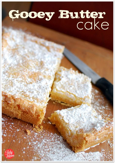 """St. Louis Gooey Butter Cake.  This is the recipe for my most requested party/tailgate dessert.  Some call it my """"Blow Cake!""""  Still not sure if that's because I top it with so much powdered sugar or because it's so addictive.  It's really BAD!"""