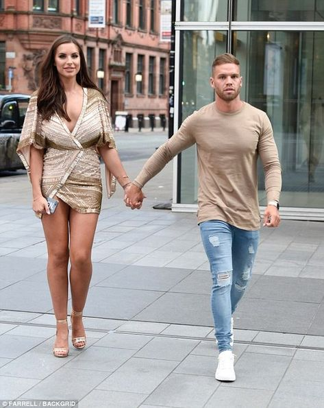 The 24-year-old glamour model flaunted her endless legs as she towered over her boyfriend in staggering heels while he sports a simple stone coloured T-shirt for the appearance