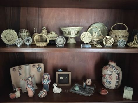 Basketry, pottery and miniatures displayed beautifully.