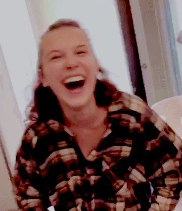 Millie Bobby Brown Laughing At Something That Finn Wolfhard Is