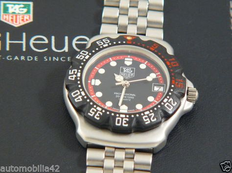 Near mint TAG Heuer Formula one F1 St. Steel w.black-red bezel and Dial 374.513