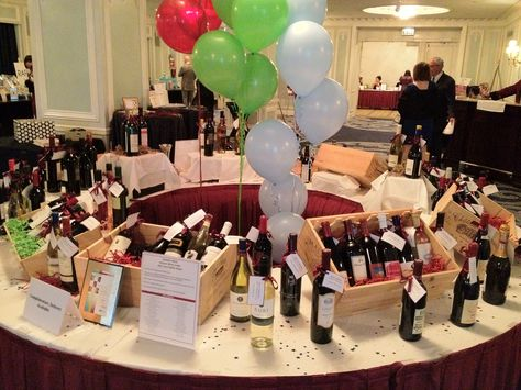 Nice Wine Raffle Display - Note the use of crates as baskets. Raffle chance to win 100 bottles of wine cost $100 with only 100 chances to win. This wine raffle fundraiser raises $10,000