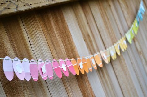 *We R* paint chip easter garland - Scrapbook.com- Make a colorful springtime banner with pantone papers or paint color samples!