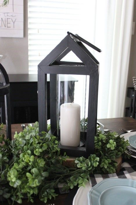 Black Wooden Lanterns Make For The Perfect Dining Table