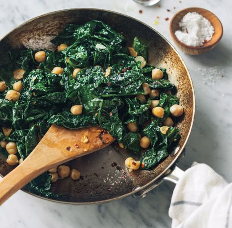 Spicy Sauteed Kale and Chickpeas: 3 large cloves garlic, very thinly sliced 1/4 cup (2 fl. oz./60 ml) olive oil 1 lb. (500 g) lacinato kale, tough stems removed, leaves coarsely chopped 1 can (14 oz./440 g) chickpeas, rinsed and drained Pinch of red pepper flakes Kosher salt