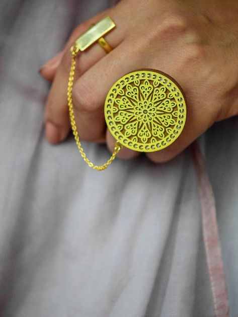 'Beautifully handcrafted this dual ring connected with a delicate chain is the highlight of this collection. Perfect for people who love a combination of Indian and oversized jewellery. S A T A T jewellery ages gracefully and looks vintage and classy as time goes by. Size - R1-38 mm Length R2- 20 mm Length x R1- 38 mm width R2- 7mm width x R1- 27 mm height R2- 20 mm Color: Yellow, Brown and Gold Unique work :Handcarving on reclaimed Teak wood For more details or need more quantity please email u