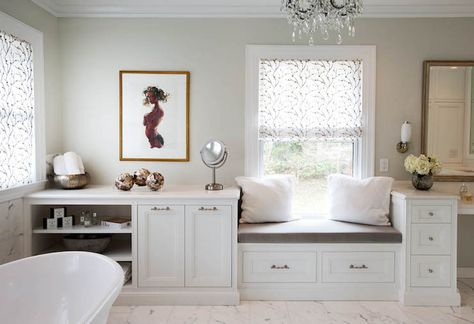 Elegant seating area in bathroom features built-in ...
