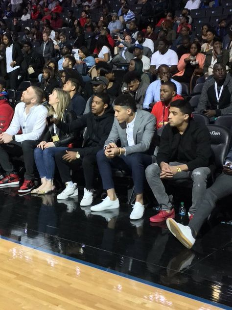 Tyler Ulis and Devin Booker sitting courtside at the @JordanClassic in Brooklyn
