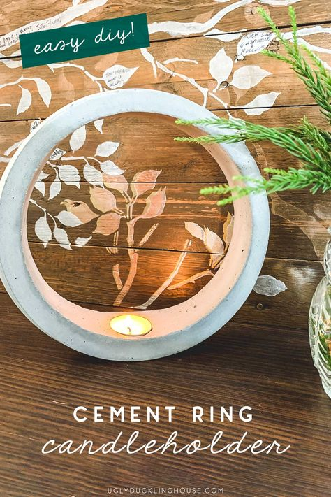 So easy! Make a ring-shaped, DIY cement candleholder. Such a cool project! Come see the step by step tutorial for this unique concrete hoop candleholder. #concrete #cement #diy #quickandeasy #homedecor #industrialdecor #candleholder #circle #hoop