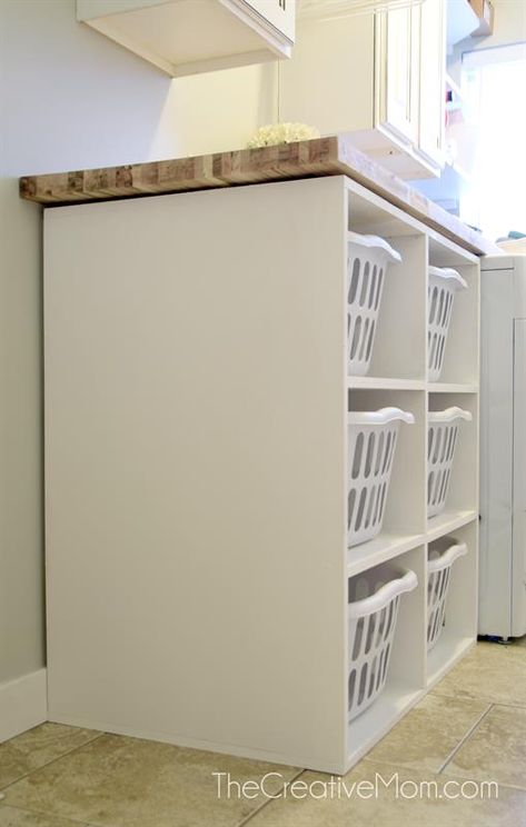 This laundry basket shelf holds 6 basic laundry baskets. It is designed to be the height of a standard washer and dryer. The dimensions can easily be .