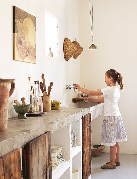 concrete counter and the barnwood cabinets