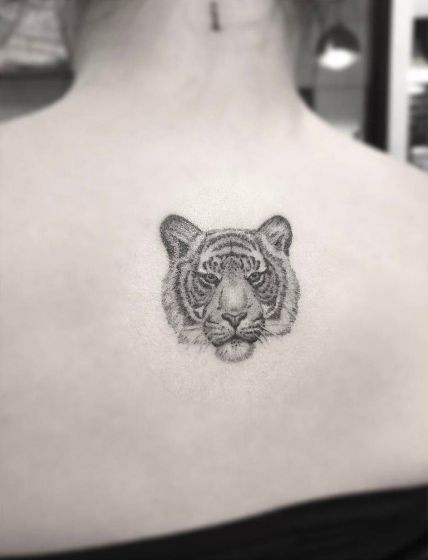 Best Animal Tattoo Designs - Tiny dotwork tiger tattoo on back by Doctor Woo...