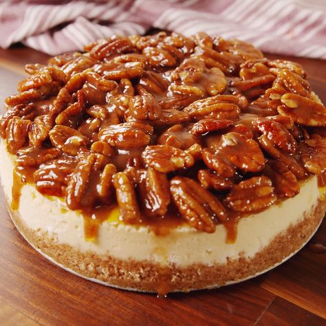 Take your pecan pie to the next level and combine it with your favorite cheesecake. You'll have a creamy base with a sweet crunchy topping that makes this the best Thanksgiving dessert ever. Get the recipe at Delish.com. #delish #easy #recipe #pecanpie #cheesecake #pie #thanksgiving #best #dessert #fallrecipe