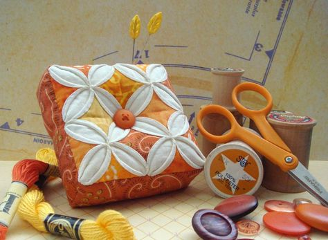 cathedral windows pin cushion - very cute...and would make a good Yule gift.