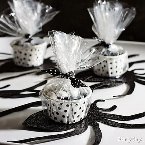 Candy cups + spider paper cutouts = eeek! Make their skin crawl with a DIY black-n-bone Halloween candy buffet!