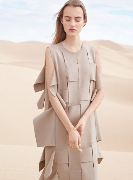 Maartje pictured in a taupe dress with weaving detail for COS' spring-summer 2016 campaign