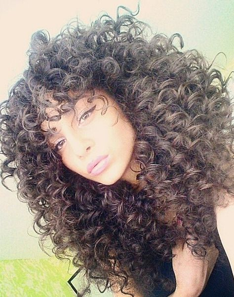 Curly hair and winged eyeliner Beauty