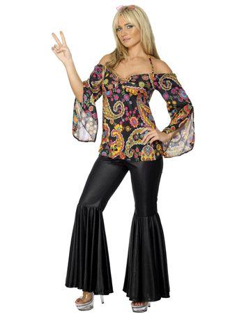 Stoere hippie dames kleding. Deze hippie dames kleding bevat een donkere broek die rond het bovenbeen strak aanloopt en op het onderbeen uitloopt. Boven de broek komt een top die over de schouders heen zit. Het is een zwarte top met geel, groene en blauwe print. Carnavalskleding 2015 #carnaval