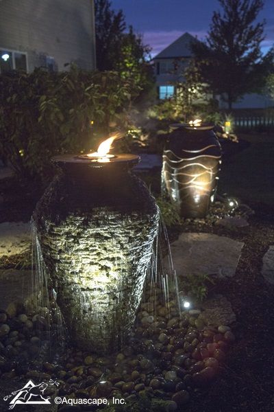 Lighting Ideas For Your Pond Waterfall Or Fountain C E Pontz Sons Landscape Contractors Pond Lights Diy Water Fountain Water Fountains Outdoor